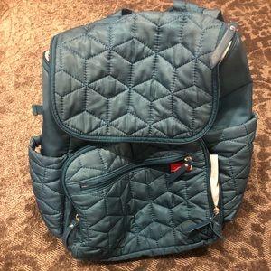 Teal Skip Hop diaper backpack.